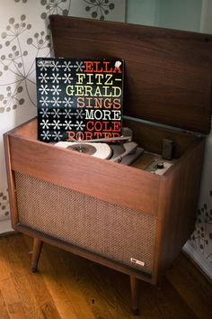 We removed the broken record player and set of up with all out gadget power cords. An old fashioned charging station!