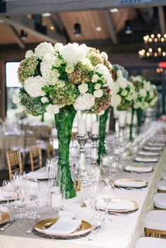 Jackson  Durham Vue Photography - green and white hydrangeas in an elevated centerpiece