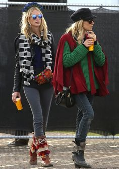 There was a lot going on with Poppy's day four look from that geometric print scarf to her ornate headpiece and those fabric boots from the second day. Sienna's ensemble was equally eclectic featuring a red cape over a green knitted sweater, studded black boots and a fisherman's cap.Image: Getty