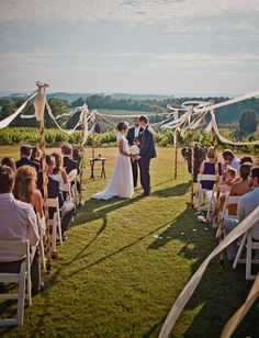 Gorgeous. I want my wedding to be like this. Simple, outdoor, and at a beautiful location. Her dress is lovely too.