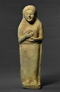 Terracotta figure of a tambourine player, Phoenician, from Tharros, Sardinia, 7th-6th century BCE. From a tomb at Tharros.