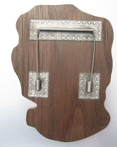 """""""Memory map 3(back)"""" by Pierce Healy. Sterling silver, wood.."""