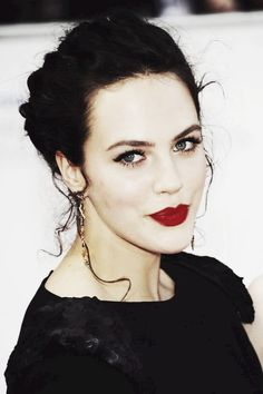 Jessica Brown Findlay with the perfect red-lip and eye make-up combination.