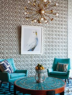 Love everything about this - especially the sputnik chandelier. (mod living room, turquoise, Jonathan Adler)