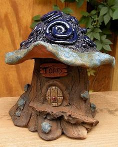 Hand made toad house offers a whimsical touch and cozy spot for toads, frogs... even fairies. Cobalt Swirls toad abode brightens up the garden while providing perfect habitat for beneficial crawly fri