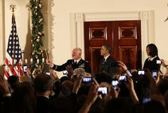 The POTUS and FLOTUS hosted a Hanukkah reception at the White House. Mrs. O is wearing a Jason Wu dress with a very pretty brooch.