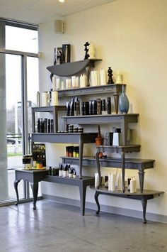 This is in a salon, but wouldn't this make a gorgeous display for essential oils & wellness supplements? Made from halves of coffee tables & end tables.