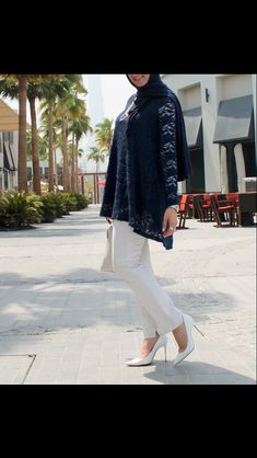 This Eid's look. Navy floral top and hijab, white pants, white Louboutin heels, white Michael Kors hand bag, silver and pearl accessories.