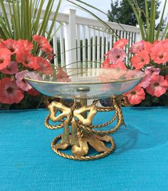 1950s Vintage Italian Gold Gilt Compote / Trinket Dish. Has a gold design on glass dish, & a gold metal stand ordained with twisted rope & bows! Great for bedroom or bathroom decor, could be used for holding jewelry, soaps, or keepsakes. In great vintage condition!  Measures 4 1/4 tall x 6 wide  Thanks for shopping YellowHouseDecor!  Please visit my sisters shop for more vintage items ( ellansrelics02)