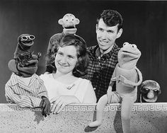 """Jim Henson and Jane Henson pose with characters from the TV show """"Sam and Friends,"""" ca. 1956. From left, Moldy Hay, Jane Henson, Sam, Harry the Hipster, Jim Henson, Kermit and Yorick."""