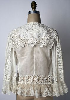 This is a bed jacket from the 1900's. There is a lot of lace and eyelets in this piece.