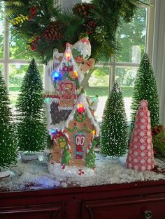 Whimsical Gingerbread Lit House or Town makes decorating fun.  H201121  http://qvc.co/ShopValerie