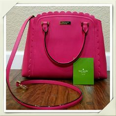 Authentic Kate Spade Leather Hot Pink Bag Authentic Kate Spade Bag. Brand NEW leather hot pink purse with gold embellishments includes detachable long strap, a zipper pocket, 2 open pockets, tag, and care card. The purse measures 12 1/2 x 9 1/2 x 5 1/2. This purse is very spacious and just the right item to add a pop of color into your outfit! kate spade Bags Shoulder Bags