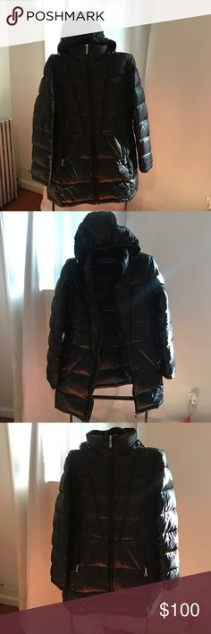 Down Jacket Calvin Clein 90% duck down Excellent condition!!! Keeps you so warm!! Size: Medium - dark brown. Light down. Long jacket. Perfect for winter. Calvin Klein Jackets & Coats Puffers