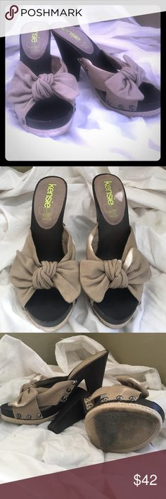 """Kensie girl bow & stud slip-on heels Burlap-looking bow with studs around the bottom front of slip on. Platform measures        1 1/4"""". Heel measures 4 1/4"""". Soft material resembles burlap silver/pewter studs. *Shoe states it's 6 1/2 (that's totally a mistake) wears more like 5 1/2. Happy shopping ❤️ Kensie Girl Shoes Sandals"""