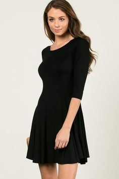 Little Black Dress with 3/4 Sleeves  If you need a new Little Black Dress, this is it!  Very versatile so you can dress up with heels or go more the casual route with flats. Love the fit and flair!  Size: Small 0/2/4/6, Medium 6/8, Large 8/10 95% Rayon 5% Spandex Hand Wash Cold/Hang to Dry Made in USA FREE SHIPPING!!!  Shop: