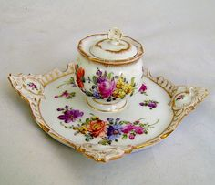 Late 19th century Dresden Inkwell attached to a stand or tray. Beautifully hand painted with florals and gilded edges.