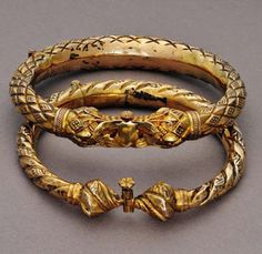 Pair of bracelets with lotus finials.  Palembang, South Sumatra.  Gilt silver    Ethnic Jewellery from Indonesia: Continuity and Evolution By Bruce W. Carpenter, page 119