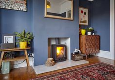 A lovely space finished with our concrete hearth and a cosy log burner. Dark Blue Living Room, Dark Blue Walls, Red Walls, Wood Burner Fireplace, Fireplace Ideas, Grey Dinning Room, White Fire Surround, Log Burner Living Room, Hearths