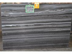 Smokey Grey 3cm Quartzite | The lines are beautiful on a waterfall edge detail. @ graniteworksmd.com Stone Slab, Granite Countertops, Maryland, Natural Stones, Kitchen Remodel, Waterfall, Marble, Yard, Bathroom