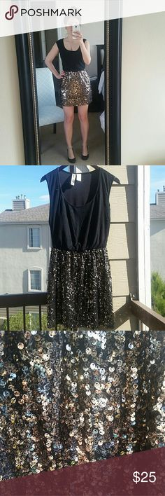 Mimi chica Gold dress Beautiful sequined dress with speckled gold skirt and black top. Lined, so it's extra comfortable. Perfect for any celebration or night out! Purchased from Nordstrom. Good condition. TTS.  Check out my closet for more great items! I offer bundle discounts and welcome offers! Mimi Chica Dresses Mini
