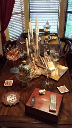 Whiskey and Cigar party. Used small whiskey bottles in decorative bowl with gems that looked like they were on ice. Cigars displayed the same and used cigar coasters for decorations. Put pool balls in a jar for added decorations to the table as well.
