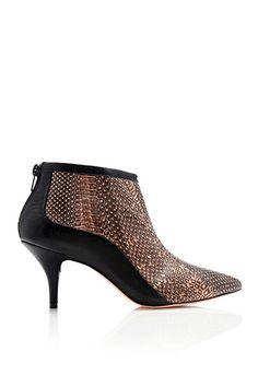 11 Low-Lying Heels That'll Take Your Style Sky-High #refinery29  http://www.refinery29.com/kitten-heels#slide3