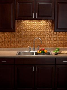 Use fasade to cover an ugly tile backsplash. Sold at most home improvement stores