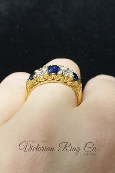 Victorian style oval sapphire and old-cut diamond half hoop ring. The ring is made from 18ct yellow gold and fits across the finger. #yellowgoldring #sapphirering #bluesapphirering #victorianhalfhoopring #victorianstyleengagementring Blue Sapphire Rings, Yellow Gold Rings, Country Rings, Victorian Engagement Rings, Conflict Free Diamonds, Rose Cut Diamond, Antique Rings, Hand Engraving, Gold Bands