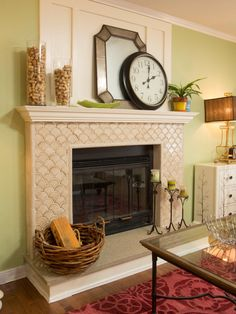 In this living-room makeover featured on HGTV's Brother Vs. Brother, fish-scale tiles add texture to the neutral fireplace without overwhelming the transitional living room. A basket, glass vases filled with corks and a large decorative clock accessorize the mantel and hearth.