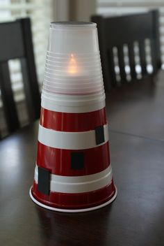 Love this lighthouse craft--red solo cup, white electrical tape, battery opp. tea light & smaller top cup. Decorate & done!