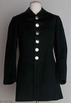 "LIVERY COAT & VEST, AMERICA, 1880s For coachman or footman: 1 black wool fitted jacket, silver buttons; 1 black & yellow striped vest w/ brown cotton backing; Sh-Sh 15"", Ch 38"", Jacket L 32"", Vest L 22"", excellent."