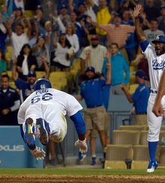 . Los Angeles Dodgers' Yasiel Puig scores on a single along with teammate Howie Kendrick on a fielding error by Washington Nationals center fielder Michael Taylor (not pictured) in the ninth inning of a Major League Baseball game on Wednesday, June 22, 2016 in Los Angeles. Los Angeles Dodgers won 4-3. (Photo by Keith Birmingham/ Pasadena Star-News) Let's Go Dodgers, Dodgers Baseball, Baseball Games, Yasiel Puig, America's Pastime, Dodger Blue, Washington Nationals, June 22, Los Angeles Dodgers
