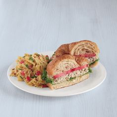 Chicken Salade Croissant -   Served on a fresh-baked croissant with lettuce and tomatoes