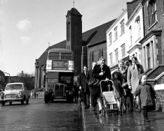 Catholic family leaving church in Harleden, 1968. London
