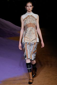 Recycling classic (the materials make me think of old curtains, a couch or a bed cover in classic decorated houses), Spring 2015, Prada