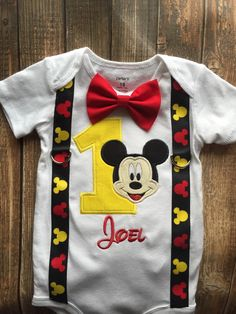 Custom boys first birthday Mickey Mouse bodysuit with suspenders and bow tie by LittleChickiesClips on Etsy https://www.etsy.com/listing/265091349/custom-boys-first-birthday-mickey-mouse