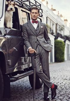 Boom! Wide stripe, waistcoat, matching red bow tie and socks. This has it all. This to me says - raffish