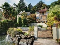 Seattle Real Estate, Denny Blaine, beautiful Mediterannean home on Lake Washington, with an exquisite temperature controled wine cellar. Just steps away from the Water, with dock and boatlift.