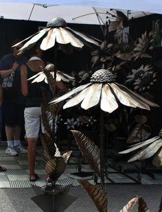 Kirk Yazel created giant flowers out of scrap metal.