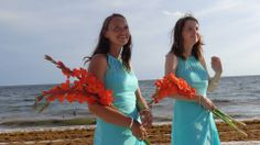 Beach Wedding Floral Decor Bridesmaids wore a Turquoise Chiffon Dress from David's Bridal with Coral/Orange Gladiolus wrapped with pearl lined burlap adorned with seashells  www.sister-secrets.com