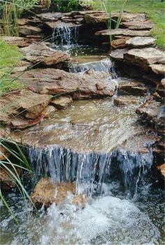 Waterfalls backyard - stream rocks Very natural looking I love the large flat rocks in the base, making look like the stream has actually been hollowed out by the running water Backyard Stream, Garden Stream, Large Backyard Landscaping, Backyard Water Feature, Ponds Backyard, Landscaping With Rocks, Backyard Ideas, Pond Design, Garden Design