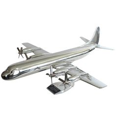 This is a large and very rare 1957 scale model aluminum Lockheed Electra. It was a promotional table top aluminum airplane model made by Lockheed to promote Persian Garden, Vintage Models, Model Airplanes, Wool Carpet, Vintage Travel Posters, Museum Of Modern Art, Green Backgrounds, No Name, Scale Models