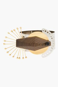 Marni Silver And Wood Deco Peacock Bracelet - Marni Silver And Wood Deco Peacock Bracelet Marni Wide_band cuff_style bracelet in silver_ and gold_tone metal. Prism_cut wooden accent at bracelet face with black accent bead and fan of gold_tone spokes. Hook_eye closure. Approx. 2.5 diameter. 1 width. Price $650.00 Click HERE for more...