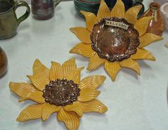 Stoneware sunflower garden heads. These screw onto threaded metal stakes that come in lengths of 3ft, 2.5ft, or 2ft.  Glazed with Duncan concepts and dipped in Pure Brilliance clear glaze and fired to cone 6.