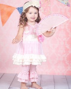 Imagine how cute your little girl will look in this! Pre-order the Giggle Moon Simply Beautiful Tutu Dress with Ruffle Capri Leggings in size 12 months-size 4.