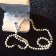 "Genuine Pearl set. NWT.  4 pcs. New in Box  Great gift for giving any time of the year. 18"" single strand of knotted genuine freshwater pearls with stainless steel lobster clasp. Matching bracelet with the same clasp. Bracelets measures approx. 7.5""... Earrings are single Pearl posts with metal and rubber backs. Comes in original gift box. These are a very nice size Pearl, not too big, not too small. The perfect size, the perfect luster. Just beautiful. Great idea for Holy Communion…"