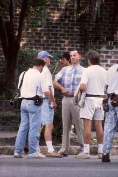 Movies Made in Savannah | savannahnow.com  Tom Hanks (center facing) stands on Bull St. near the intersection of 48th St. during filming of 'Forest Gump' in Savannah. (John  Carrington/Savannah Morning News)  #RevSchulte