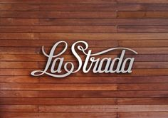 typography inspiration - love the font and the look of the wood behind the silver.