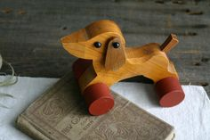 Rolling wood toy dog dachshund via Etsy.